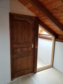 Porte coulissante assemblée épicéa et vitrage fixe latéral